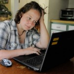 Girl at laptop from cyber bullying article